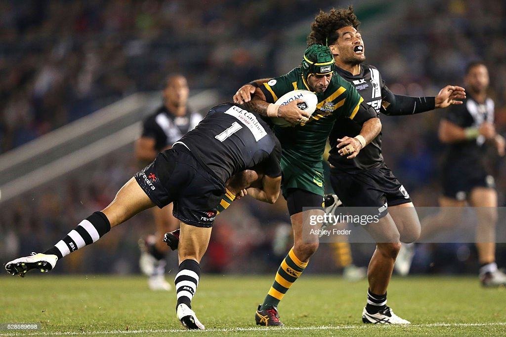 Jonathan Thurston of the Kangaroos is tackled by <a gi-track='captionPersonalityLinkClicked' href=/galleries/search?phrase=Adam+Blair&family=editorial&specificpeople=709053 ng-click='$event.stopPropagation()'>Adam Blair</a> of the Kiwis during the International Rugby League Trans Tasman Test match between the Australian Kangaroos and the New Zealand Kiwis at Hunter Stadium on May 6, 2016 in Newcastle, Australia.