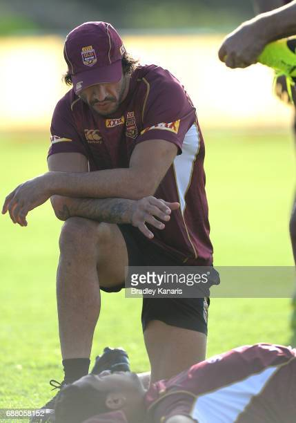 Jonathan Thurston speaks with team mate Anthony Milford during a Queensland Maroons State of Origin media opportunity at InterContinental Sanctuary...