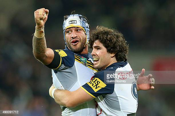 Jonathan Thurstonand Jake Granville of the Cowboys celebrate a try during the NRL Second Preliminary Final match between the Melbourne Storm and the...