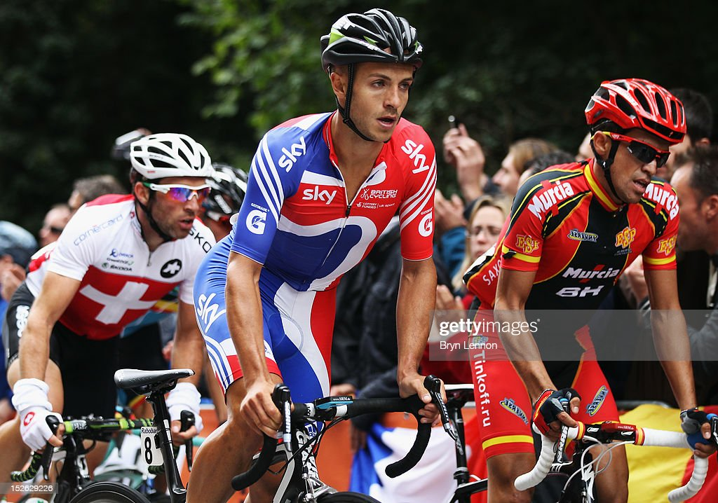 Jonathan Tiernan-Locke (l) of Great Britain climbs The Cauberg alongside Alberto Contador of Spain during the Men's Elite Road Race on day eight of the UCI Road World Championships on September 23, 2012 in Valkenburg, Netherlands.