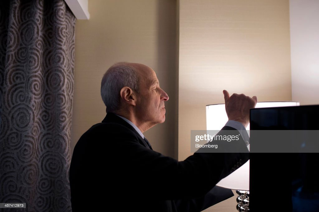 Jonathan Tisch, co-chairman of New York-based Loews Corp., adjusts a lamp in a room at the newly renovated Loews Regency Hotel on Park Avenue in New York, U.S., on Tuesday, Dec. 17, 2013. 'We've been getting a lot of interest in the hotel,' said Tisch. 'We anticipate we'll get good returns on our investment.' Photographer: Victor J. Blue/Bloomberg via Getty Images