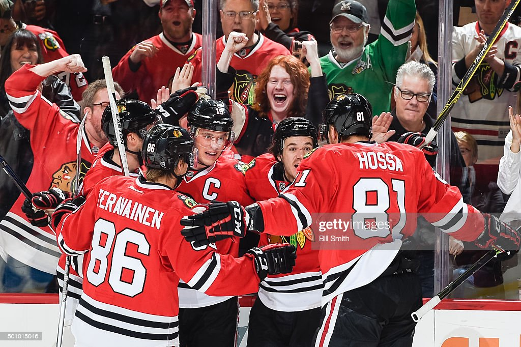 <a gi-track='captionPersonalityLinkClicked' href=/galleries/search?phrase=Jonathan+Toews&family=editorial&specificpeople=537799 ng-click='$event.stopPropagation()'>Jonathan Toews</a> #19 and <a gi-track='captionPersonalityLinkClicked' href=/galleries/search?phrase=Andrew+Shaw+-+Joueur+de+hockey+sur+glace&family=editorial&specificpeople=10568695 ng-click='$event.stopPropagation()'>Andrew Shaw</a> #65 of the Chicago Blackhawks celebrate with teammates after Toews scored against the Winnipeg Jets in the first period of the NHL game at the United Center on December 11, 2015 in Chicago, Illinois.