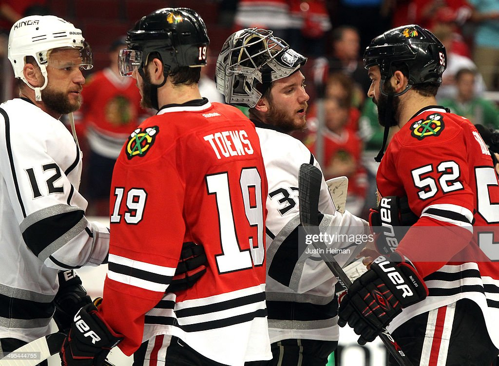 Jonathan Toews #19 and Brandon Bollig #52 of the Chicago Blackhawks shake hands with Marian Gaborik #12 and Jonathan Quick #32 of the Los Angeles Kings after Game Seven of the Western Conference Final in the 2014 Stanley Cup Playoffs at United Center on June 1, 2014 in Chicago, Illinois.