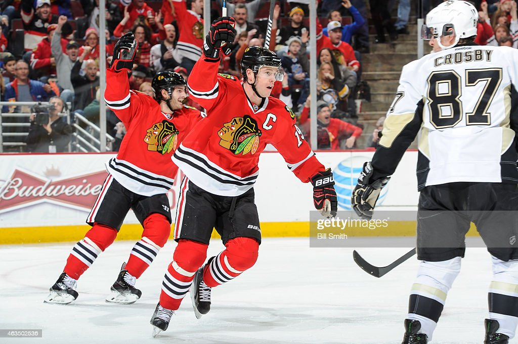 Jonathan Toews #19 and Brandon Saad #20 of the Chicago Blackhawks react after the Blackhawks scored against the Pittsburgh Penguins in the second period during the NHL game at the United Center on February 15, 2015 in Chicago, Illinois.
