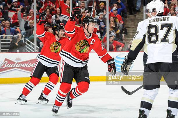 Jonathan Toews and Brandon Saad of the Chicago Blackhawks react after the Blackhawks scored against the Pittsburgh Penguins in the second period...