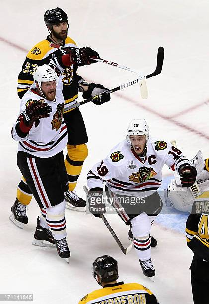Jonathan Toews and Bryan Bickell of the Chicago Blackhawks celebrate after Brent Seabrook scored the gamewinning goal in overtime to give them a 65...