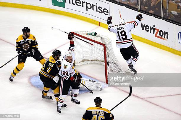 Jonathan Toews and Bryan Bickell of the Chicago Blackhawks celebrates after Toews scores a goal against Tuukka Rask of the Boston Bruins during the...