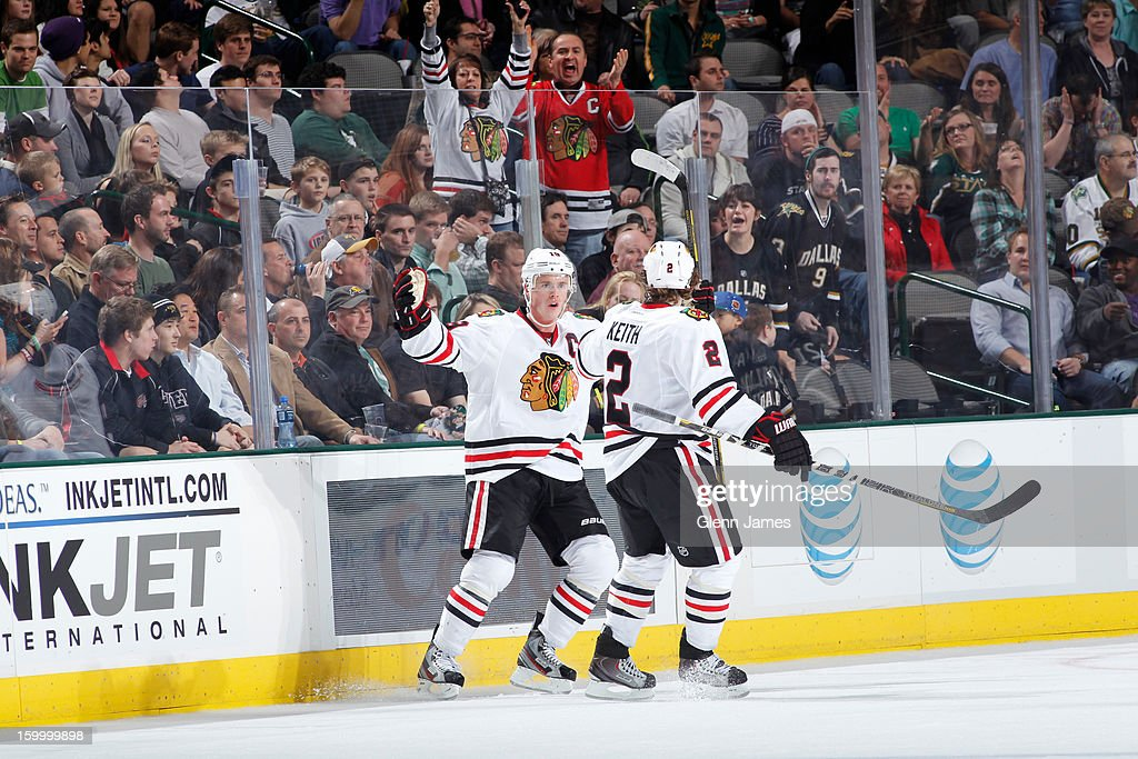 Jonathan Toews #19 and Duncan Keith #2 of the Chicago Blackhawks celebrate a goal against the Dallas Stars at the American Airlines Center on January 24, 2013 in Dallas, Texas.