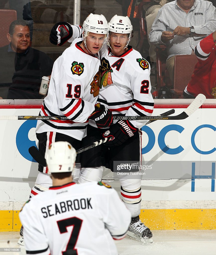Jonathan Toews #19 and Duncan Keith #2 of the Chicago Blackhawks celebrate a first-period goal by Toews during the game against the Anaheim Ducks on March 20, 2013 at Honda Center in Anaheim, California.