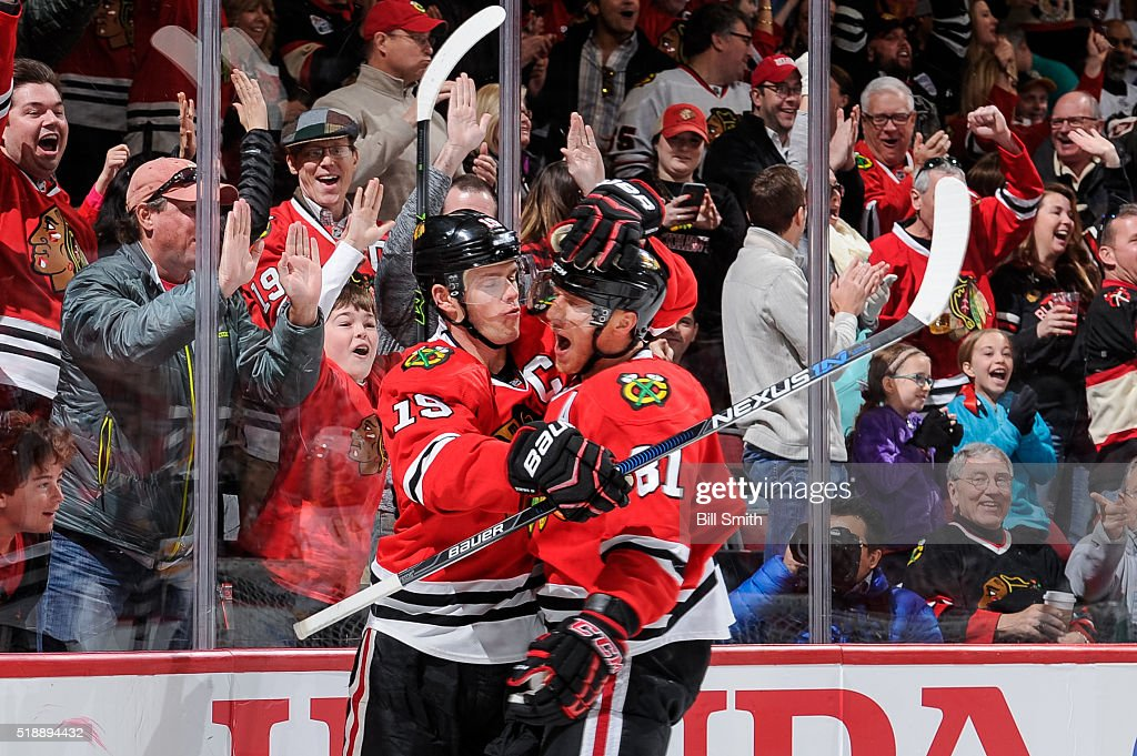 <a gi-track='captionPersonalityLinkClicked' href=/galleries/search?phrase=Jonathan+Toews&family=editorial&specificpeople=537799 ng-click='$event.stopPropagation()'>Jonathan Toews</a> #19 and <a gi-track='captionPersonalityLinkClicked' href=/galleries/search?phrase=Marian+Hossa&family=editorial&specificpeople=202233 ng-click='$event.stopPropagation()'>Marian Hossa</a> #81 of the Chicago Blackhawks react after Toews scored against the Boston Bruins in the second period of the NHL game at the United Center on April 3, 2016 in Chicago, Illinois.