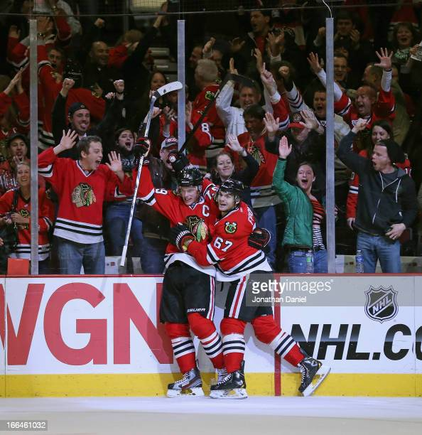 Jonathan Toews and Michael Frolik of the Chicago Blackhawks celebrate Toew's gametying goal against the Detroit Red Wings at the United Center on...