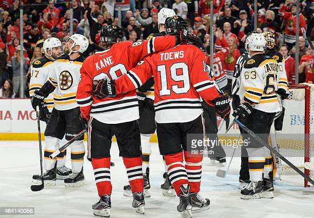 Jonathan Toews and Patrick Kane of the Chicago Blackhawks celebrate after Toews scored against the Boston Bruins in the first period during the NHL...