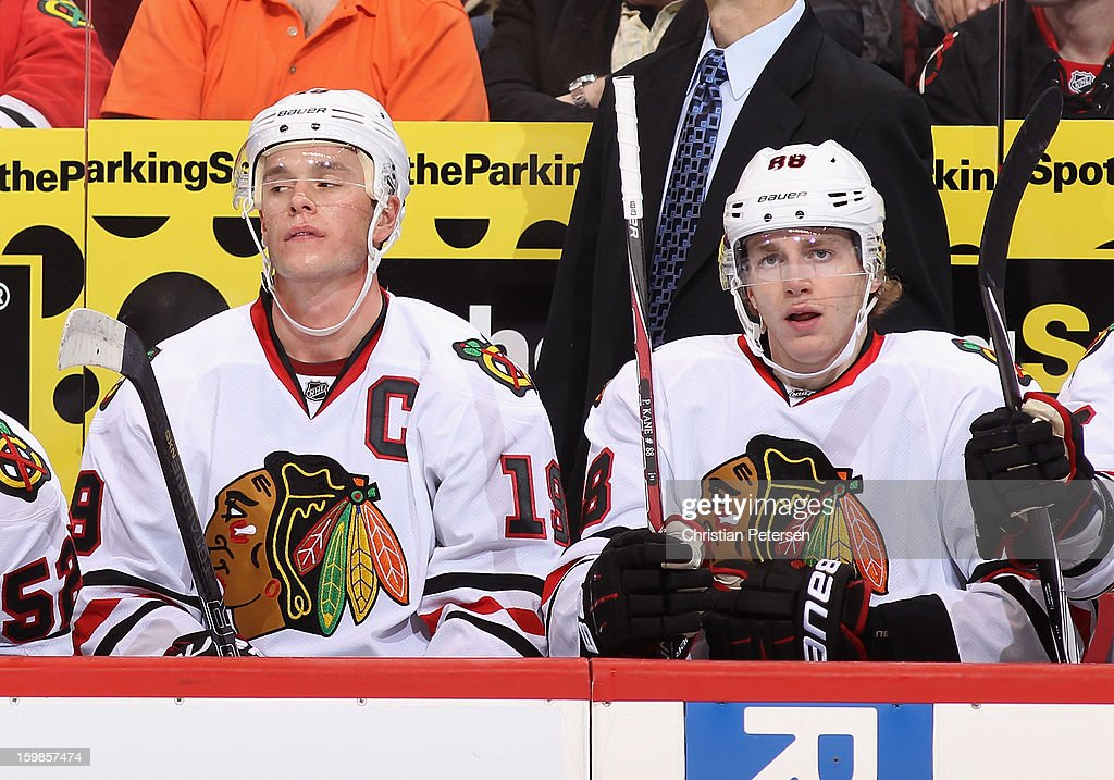 Jonathan Toews #19 and Patrick Kane #88 of the Chicago Blackhawks on the bench during the NHL game against the Phoenix Coyotes at Jobing.com Arena on January 20, 2013 in Glendale, Arizona. The Blackhawks defeated the Coyotes 6-4.