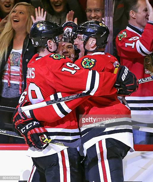 Jonathan Toews Andrew Shaw and Marian Hossa of the Chicago Blackhawks celebrate a goal by Hossa in the second period against the Colorado Avalanche...