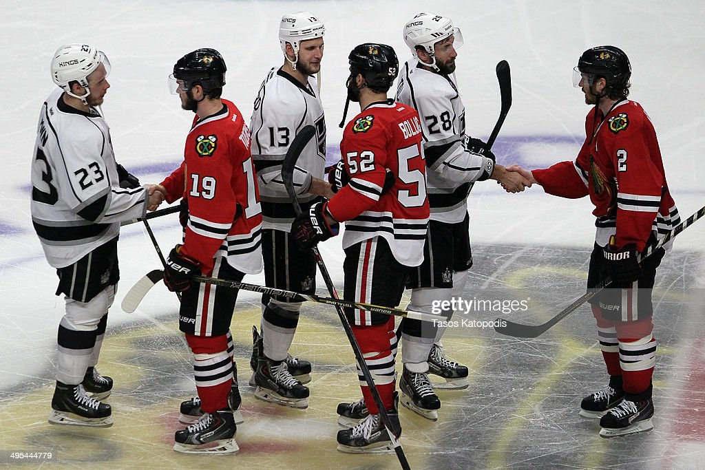Jonathan Toews #19, Brandon Bollig #52 and Matt Greene #2 of the Chicago Blackhawks shake hands with Dustin Brown #23, Kyle Clifford #13 and Jarret Stoll #28 of the Los Angeles Kings after Game Seven of the Western Conference Final in the 2014 Stanley Cup Playoffs at United Center on June 1, 2014 in Chicago, Illinois.
