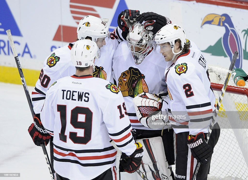 <a gi-track='captionPersonalityLinkClicked' href=/galleries/search?phrase=Jonathan+Toews&family=editorial&specificpeople=537799 ng-click='$event.stopPropagation()'>Jonathan Toews</a> #19, <a gi-track='captionPersonalityLinkClicked' href=/galleries/search?phrase=Brandon+Saad&family=editorial&specificpeople=7128385 ng-click='$event.stopPropagation()'>Brandon Saad</a> #20, <a gi-track='captionPersonalityLinkClicked' href=/galleries/search?phrase=Ray+Emery&family=editorial&specificpeople=218109 ng-click='$event.stopPropagation()'>Ray Emery</a> #30 and <a gi-track='captionPersonalityLinkClicked' href=/galleries/search?phrase=Duncan+Keith&family=editorial&specificpeople=4194433 ng-click='$event.stopPropagation()'>Duncan Keith</a> #2 of the Chicago Blackhawks celebrate a win of the game against the Minnesota Wild on April 9, 2013 at Xcel Energy Center in St Paul, Minnesota. The Blackhawks defeated the Wild 1-0.