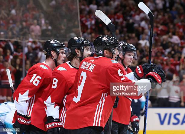 Jonathan Toews celebrates with Matt Duchene and Drew Doughty of Team Canada after scoring a first period goal Team Europe during the World Cup of...