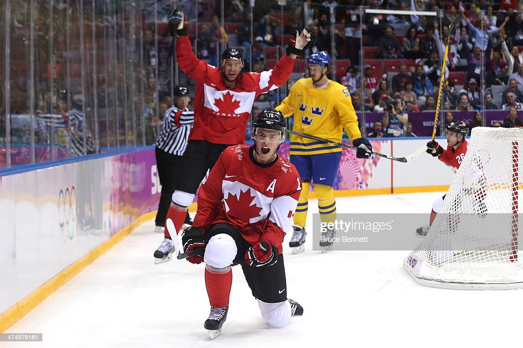 Jonathan Toews of Canada celebrates after scoring a firstperiod goal against Henrik Lundqvist of Sweden during the Men's Ice Hockey Gold Medal match...