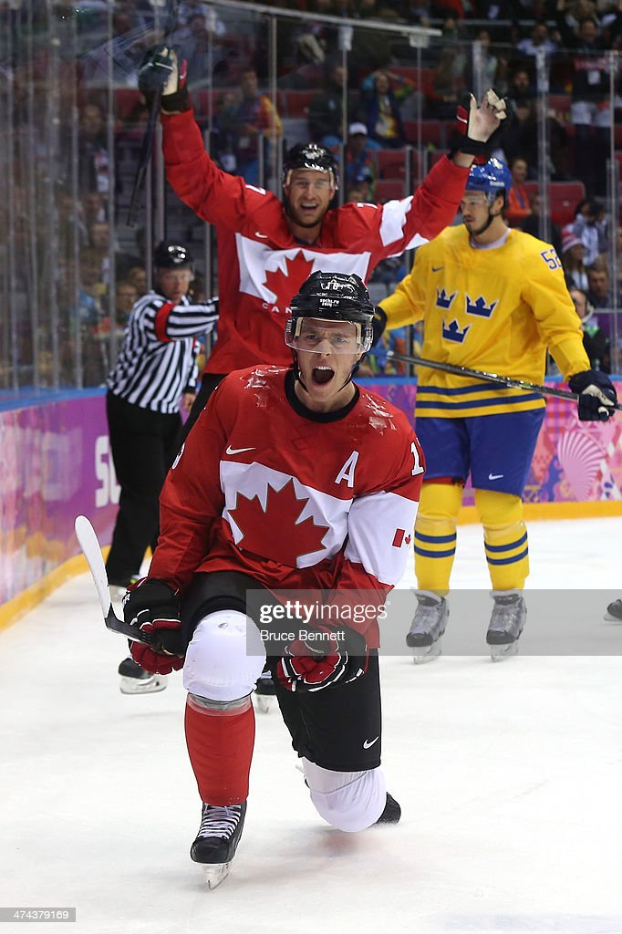 <a gi-track='captionPersonalityLinkClicked' href=/galleries/search?phrase=Jonathan+Toews&family=editorial&specificpeople=537799 ng-click='$event.stopPropagation()'>Jonathan Toews</a> #16 of Canada celebrates after scoring a first-period goal against <a gi-track='captionPersonalityLinkClicked' href=/galleries/search?phrase=Henrik+Lundqvist&family=editorial&specificpeople=217958 ng-click='$event.stopPropagation()'>Henrik Lundqvist</a> #30 of Sweden during the Men's Ice Hockey Gold Medal match on Day 16 of the 2014 Sochi Winter Olympics at Bolshoy Ice Dome on February 23, 2014 in Sochi, Russia.