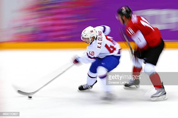 Jonathan Toews of Canada challenges Ken Andre Olimb of Norway for the puck during the Men's Ice Hockey Preliminary Round Group B game on day six of...
