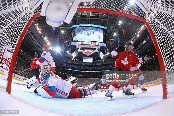Jonathan Toews of Team Canada celebrates a third period goal by Corey Perry against Sergei Bobrovsky of Team Russia at the semifinal game during the...