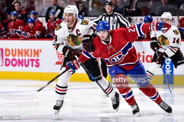 Jonathan Toews of the Chicago Blackhawks and Alex Galchenyuk of the Montreal Canadiens skate against each other during the NHL game at the Bell...