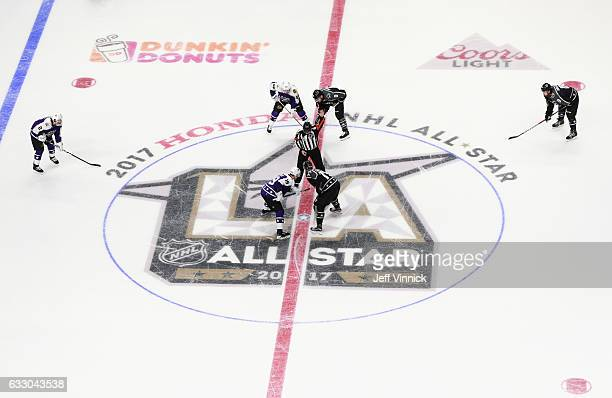 Jonathan Toews of the Chicago Blackhawks and Jeff Carter of the Los Angeles Kings take the opening faceoff to start the game between the Central...