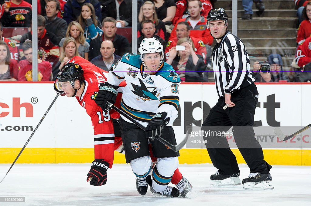 <a gi-track='captionPersonalityLinkClicked' href=/galleries/search?phrase=Jonathan+Toews&family=editorial&specificpeople=537799 ng-click='$event.stopPropagation()'>Jonathan Toews</a> #19 of the Chicago Blackhawks and <a gi-track='captionPersonalityLinkClicked' href=/galleries/search?phrase=Logan+Couture&family=editorial&specificpeople=809700 ng-click='$event.stopPropagation()'>Logan Couture</a> #39 of the San Jose Sharks collide during the NHL game on February 22, 2013 at the United Center in Chicago, Illinois.