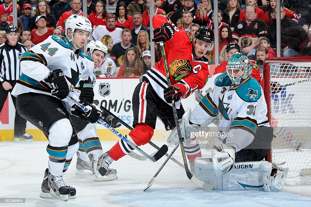 <a gi-track='captionPersonalityLinkClicked' href=/galleries/search?phrase=Jonathan+Toews&family=editorial&specificpeople=537799 ng-click='$event.stopPropagation()'>Jonathan Toews</a> #19 of the Chicago Blackhawks and <a gi-track='captionPersonalityLinkClicked' href=/galleries/search?phrase=Marc-Edouard+Vlasic&family=editorial&specificpeople=880807 ng-click='$event.stopPropagation()'>Marc-Edouard Vlasic</a> #44 of the San Jose Sharks fight for position in front of Sharks goalie <a gi-track='captionPersonalityLinkClicked' href=/galleries/search?phrase=Antti+Niemi&family=editorial&specificpeople=213913 ng-click='$event.stopPropagation()'>Antti Niemi</a> #31 during the NHL game on February 22, 2013 at the United Center in Chicago, Illinois.