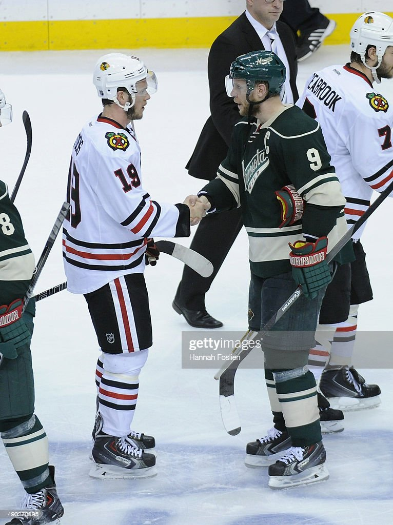<a gi-track='captionPersonalityLinkClicked' href=/galleries/search?phrase=Jonathan+Toews&family=editorial&specificpeople=537799 ng-click='$event.stopPropagation()'>Jonathan Toews</a> #19 of the Chicago Blackhawks and <a gi-track='captionPersonalityLinkClicked' href=/galleries/search?phrase=Mikko+Koivu&family=editorial&specificpeople=584987 ng-click='$event.stopPropagation()'>Mikko Koivu</a> #9 of the Minnesota Wild shake hands after Game Six of the Second Round of the 2014 NHL Stanley Cup Playoffs on May 13, 2014 at Xcel Energy Center in St Paul, Minnesota. The Blackhawks defeated the Wild 2-1 in overtime.