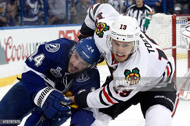 Jonathan Toews of the Chicago Blackhawks and Ryan Callahan of the Tampa Bay Lightning battle for the puck during Game One of the 2015 NHL Stanley Cup...
