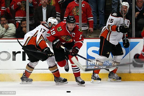 Jonathan Toews of the Chicago Blackhawks and Ryan Kesler of the Anaheim Ducks battle for a loose puck in the closing minutes of Game Three of the...