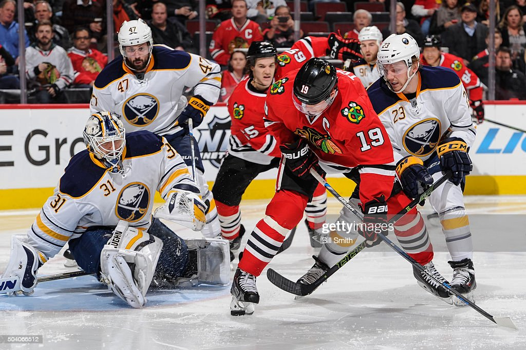 <a gi-track='captionPersonalityLinkClicked' href=/galleries/search?phrase=Jonathan+Toews&family=editorial&specificpeople=537799 ng-click='$event.stopPropagation()'>Jonathan Toews</a> #19 of the Chicago Blackhawks and <a gi-track='captionPersonalityLinkClicked' href=/galleries/search?phrase=Sam+Reinhart&family=editorial&specificpeople=9984450 ng-click='$event.stopPropagation()'>Sam Reinhart</a> #23 of the Buffalo Sabres battle for the puck in front of goalie <a gi-track='captionPersonalityLinkClicked' href=/galleries/search?phrase=Chad+Johnson+-+Ice+Hockey+Player&family=editorial&specificpeople=10960160 ng-click='$event.stopPropagation()'>Chad Johnson</a> #31 in the second period of the NHL game at the United Center on January 8, 2016 in Chicago, Illinois.