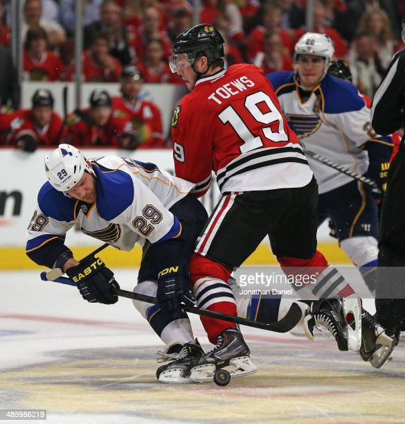 Jonathan Toews of the Chicago Blackhawks and Steve Ott of the St Louis Blues battle for the puck during a third period faceoff in Game Three of the...