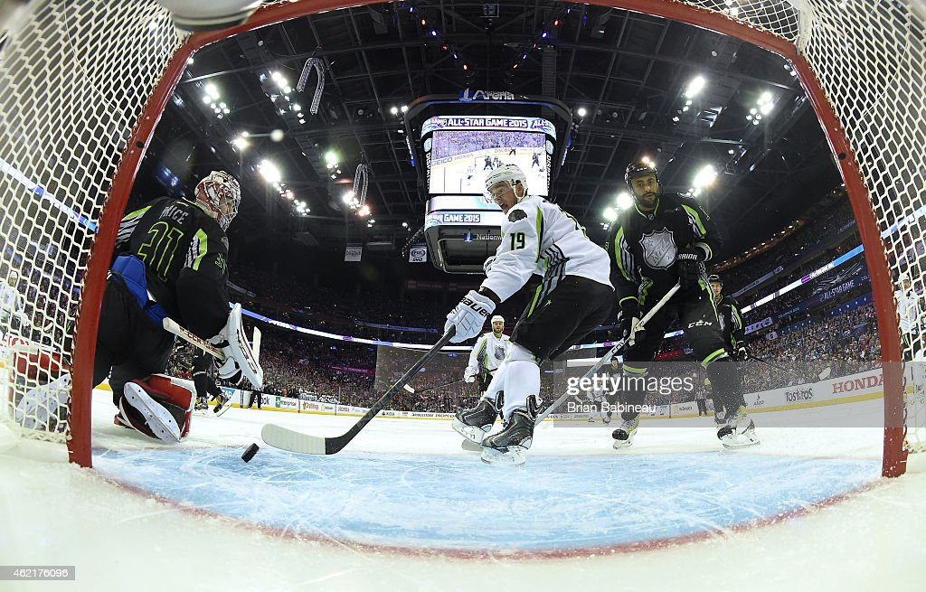 <a gi-track='captionPersonalityLinkClicked' href=/galleries/search?phrase=Jonathan+Toews&family=editorial&specificpeople=537799 ng-click='$event.stopPropagation()'>Jonathan Toews</a> #19 of the Chicago Blackhawks and Team Toews can't control the puck for the shot on goal as goaltender <a gi-track='captionPersonalityLinkClicked' href=/galleries/search?phrase=Carey+Price&family=editorial&specificpeople=2222083 ng-click='$event.stopPropagation()'>Carey Price</a> #31 of the Montreal Canadiens and Team Foligno and <a gi-track='captionPersonalityLinkClicked' href=/galleries/search?phrase=Dustin+Byfuglien&family=editorial&specificpeople=672505 ng-click='$event.stopPropagation()'>Dustin Byfuglien</a> #33 of the Winnipeg Jets and Team Foligno look on in the first period of the 2015 Honda NHL All-Star Game at Nationwide Arena on January 25, 2015 in Columbus, Ohio.