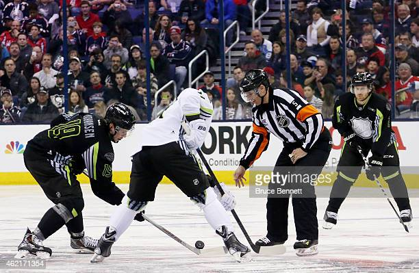 Jonathan Toews of the Chicago Blackhawks and Team Toews faces off against Ryan Johansen of the Columbus Blue Jackets and Team Foligno during the 2015...