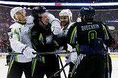 Jonathan Toews of the Chicago Blackhawks and Team Toews jokes around with Ryan Johansen of the Columbus Blue Jackets and Team Foligno headlock during...