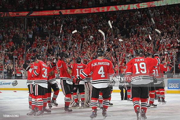 Jonathan Toews of the Chicago Blackhawks and teammates salute the fans after winning 21 in overtime after Game Seven of the Western Conference...