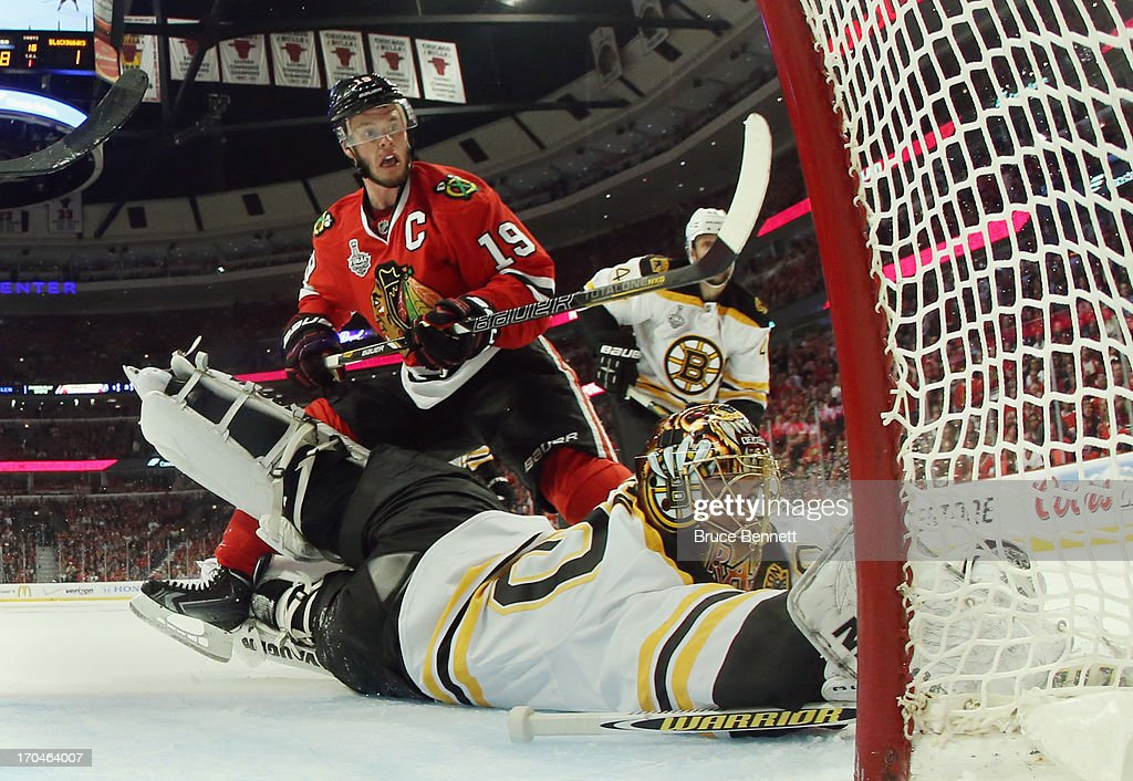 <a gi-track='captionPersonalityLinkClicked' href=/galleries/search?phrase=Jonathan+Toews&family=editorial&specificpeople=537799 ng-click='$event.stopPropagation()'>Jonathan Toews</a> #19 of the Chicago Blackhawks attacks the net against <a gi-track='captionPersonalityLinkClicked' href=/galleries/search?phrase=Tuukka+Rask&family=editorial&specificpeople=716723 ng-click='$event.stopPropagation()'>Tuukka Rask</a> #40 of the Boston Bruins at the United Center during Game One of the NHL 2013 Stanley Cup Final on June 12, 2013 in Chicago, Illinois. The Blackhawks defeated the Bruins 4-3 in the third overtime period.