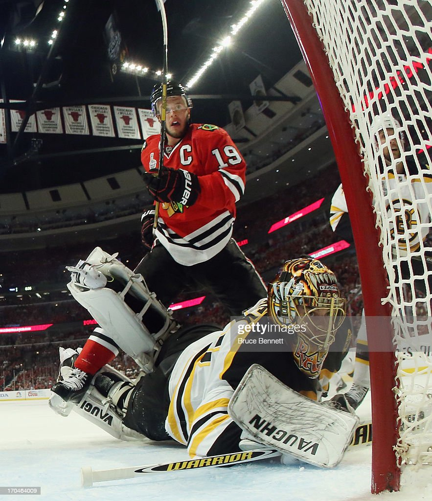 Jonathan Toews #19 of the Chicago Blackhawks attacks the net against Tuukka Rask #40 of the Boston Bruins at the United Center during Game One of the NHL 2013 Stanley Cup Final on June 12, 2013 in Chicago, Illinois. The Blackhawks defeated the Bruins 4-3 in the third overtime period.