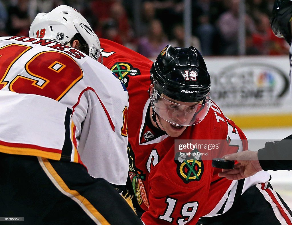 <a gi-track='captionPersonalityLinkClicked' href=/galleries/search?phrase=Jonathan+Toews&family=editorial&specificpeople=537799 ng-click='$event.stopPropagation()'>Jonathan Toews</a> #19 of the Chicago Blackhawks awaits a face-off with Blair Jones #19 of the Calgary Flames at the United Center on April 26, 2013 in Chicago, Illinois. The Blackhawks defeated the Flames 3-1.