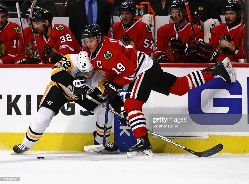 Jonathan Toews #19 of the Chicago Blackhawks battles for the puck with Ian Cole #28 of the Pittsburgh Penguins at the United Center on March 1, 2017 in Chicago, Illinois.