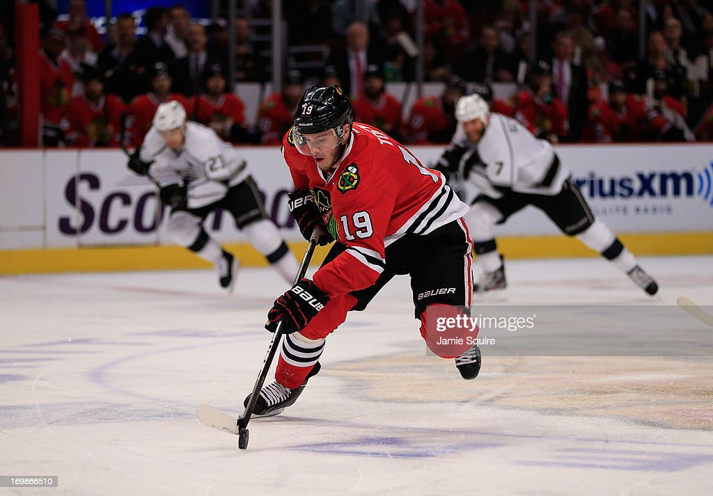 <a gi-track='captionPersonalityLinkClicked' href=/galleries/search?phrase=Jonathan+Toews&family=editorial&specificpeople=537799 ng-click='$event.stopPropagation()'>Jonathan Toews</a> #19 of the Chicago Blackhawks carries the puck through the neutral zone in the first period of Game Two of the Western Conference Final against the Los Angeles Kings during the 2013 NHL Stanley Cup Playoffs at United Center on June 2, 2013 in Chicago, Illinois. The Blackhawks defeated the Kings 4-2.