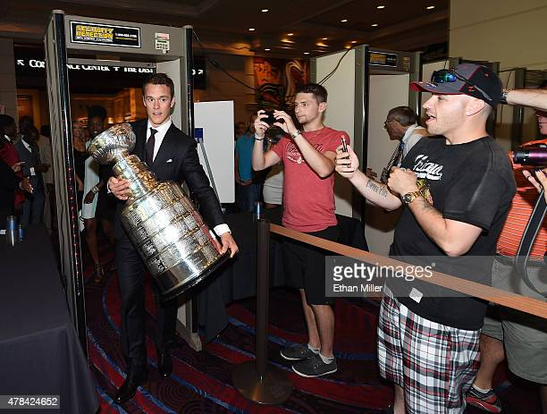 Jonathan Toews of the Chicago Blackhawks carries the Stanley Cup through a metal detector as he arrives at the 2015 NHL Awards at MGM Grand Garden...