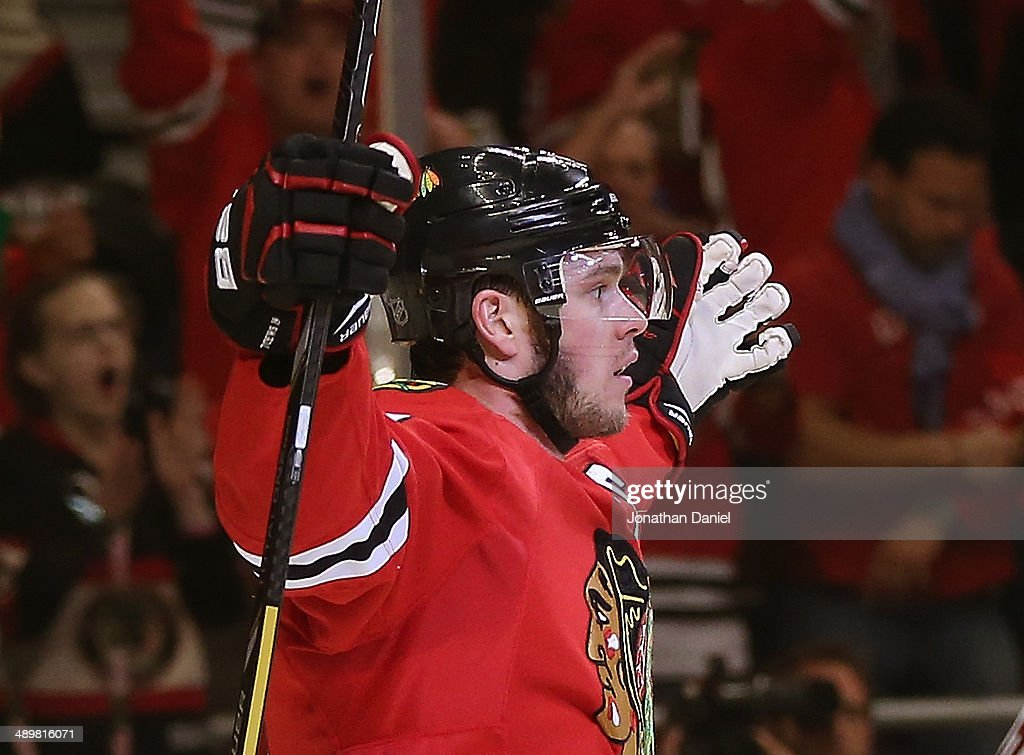 <a gi-track='captionPersonalityLinkClicked' href=/galleries/search?phrase=Jonathan+Toews&family=editorial&specificpeople=537799 ng-click='$event.stopPropagation()'>Jonathan Toews</a> #19 of the Chicago Blackhawks celebrates a goal against the Minnesota Wild in Game Five of the Second Round of the 2014 NHL Stanley Cup Playoffs at the United Center on May 11, 2014 in Chicago, Illinois. The Blackhawks defeated the Wild 2-1.