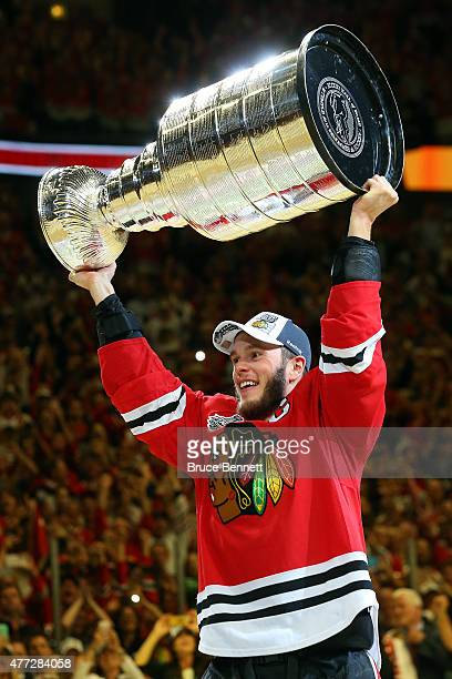 Jonathan Toews of the Chicago Blackhawks celebrates by hoisting the Stanley Cup after defeating the Tampa Bay Lightning by a score of 20 in Game Six...