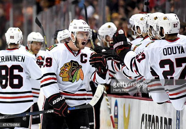 Jonathan Toews of the Chicago Blackhawks celebrates scoring his second goal in the third period with teammates in Game Five of the Western Conference...