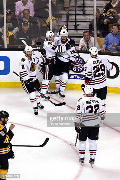 Jonathan Toews of the Chicago Blackhawks celebrates with Duncan Keith Patrick Kane and Bryan Bickell after scoring a goal in the second period...