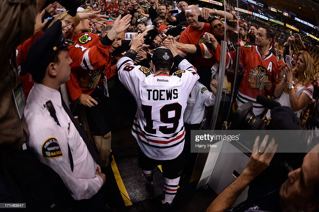 Jonathan Toews #19 of the Chicago Blackhawks celebrates with fans following their 3-2 win against the Boston Bruins in Game Six of the 2013 NHL Stanley Cup Final at TD Garden on June 24, 2013 in Boston, Massachusetts.