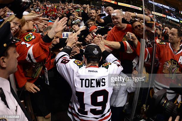 Jonathan Toews of the Chicago Blackhawks celebrates with fans following their 32 win against the Boston Bruins in Game Six of the 2013 NHL Stanley...